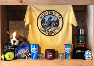 Assorted items - Mugs, shirts, and more